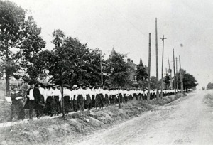 The Blue Line (ca. 1900) being led by President David Bancroft Johnson up Oakland Avenue with the President's House in the background.