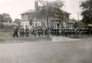 Blue Line being Led by President David Bancroft Johnson up Oakland Avenue with the President's House in the background - 1926
