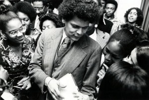 "This image is of social activist and civil rights leader Julian Bond talking with Winthrop students following a lecture as part of the 1975 Black Week activities. Black Week was a series of activities sponsored by the Winthrop Association of Ebonites to ""stimulate awareness of black culture."""